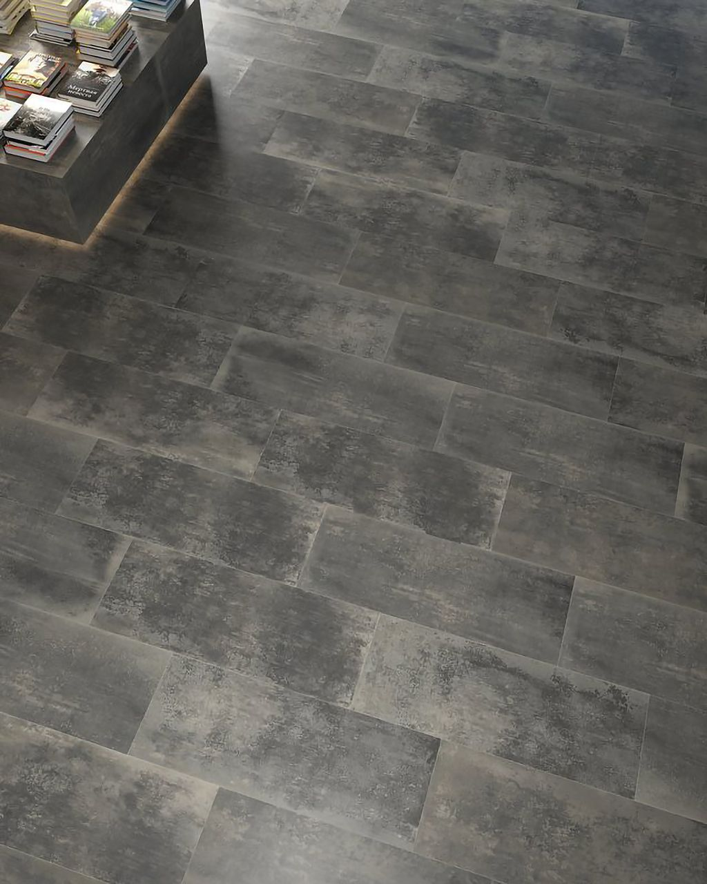An angle view of the shade variation of our Planet Gris 18 x 47 Porcelain Tile